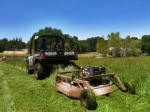 John Deere Gator XUV 825i with towable rough cut field mower