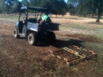 Polaris Ranger EV pulling a drag harrow