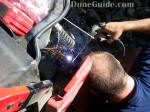 Aaron welding the tie rod on the Arctic Cat Prowler