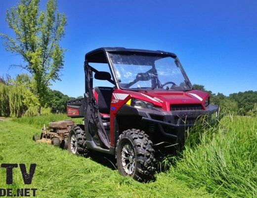 2013 Polaris RANGER XP 900 Sunset Red LE towing a Kunz AcrEase Rough Cut Mower
