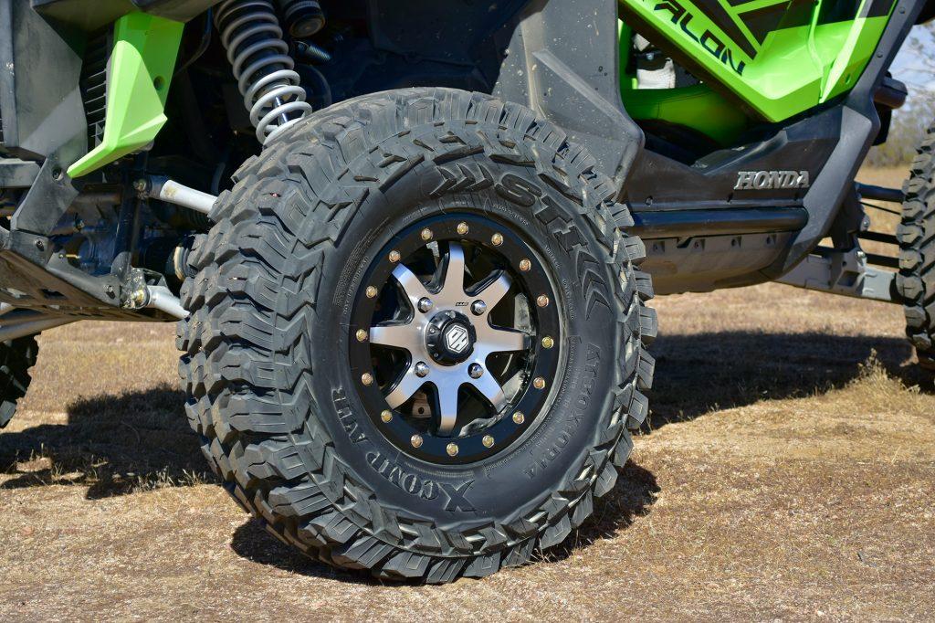 "STI HD9 Comp Lock Wheel Wrapped in 30"" XComp Tires."